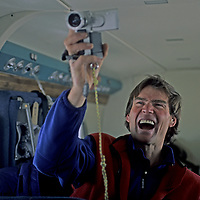 BAFFIN ISLAND, Nunavut, Canada. Alex Lowe (MR) exults after shooting video of spectacular Arctic mountains during aerial scout in search of rock climbing objectives.