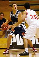 Basketball<br /> BLNO 2004/2005<br /> Bærums Verk Jets v Tromsø Storm<br /> 10.10.2004<br /> Foto: Morten Olsen, Digitalsport<br /> <br /> Tage Samuelsen - Tromsø<br /> David Baldwin - Bærum