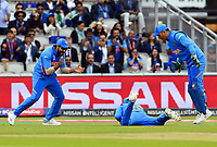 Cricket - 2019 ICC Cricket World Cup - 1st Semi-final - India vs New Zealand<br /> <br /> India's Virat Kohli catches New Zealand's Martin Guptill off the bowling of India's Jasprit Bumrah for 1 at Old Trafford.<br /> <br /> COLORSPORT/ASHLEY WESTERN