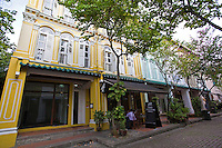 Peranakan Architecture - A shophouse is a vernacular architectural building type that is unique to Southeast Asia. This hybrid building form characterises many  towns in the region, especially Singapore.  Traditionally, many shophouses would have been plastered an off-white colour. Other popular early colours were indigo and ochre, given the range of available pigments. By the mid-20th century, pastel colours (rose pink, baby blue, light yellow, etc) became popular, and they remain the colours that most people most strongly associate with these buildings.