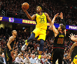 April 18, 2018 - Cleveland, OH, USA - The Indiana Pacers' Myles Turner (33) puts the ball in over the Cleveland Cavaliers' Kyle Korver in the first quarter of Game 2 of a first-round NBA playoff series on Wednesday, April 18, 2018, at the Quicken Loans Arena in Cleveland. (Credit Image: © Leah Klafczynski/TNS via ZUMA Wire)