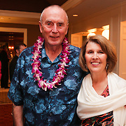 Bill Maphis, left, and Barbara Maphis pose for a photo Saturday August 2, 2014 during Pipeline to a Cure, a benefit for Cystic Fibrosis at the Country Club of Landfall in Wilmington, N.C. (Jason A. Frizzelle)