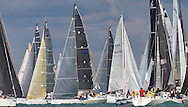 Yachts and competitors gather at the start of the 90th anniversary Rolex Fastnet Race on the Solent. A record fleet of 370 yachts will compete to win the Fastnet Challenge Cup.<br /> The 600 nautical mile race starts in Cowes, Isle of Wight, heading to the Fastnet Rock off the south west coast of Ireland and finishes in Plymouth.<br /> It is the world's biggest offshore race with 75% amateur sailors and professional yachtsmen competing against each other. <br /> Picture date Sunday 16th August, 2015.<br /> Picture by Christopher Ison. Contact +447544 044177 chris@christopherison.com