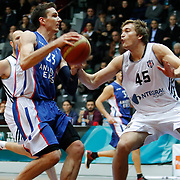 Besiktas integral Forex's Ryan Broekhoff (R) and Anadolu Efes's Matthew Janning (L) during their Turkish basketball league match Besiktas integral Forex between Anadolu Efes at BJK Akatlar Arena in Istanbul, Turkey, Monday, January 05, 2015. Photo by TURKPIX