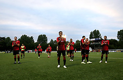 Shkendija players applaud the fans at the end of the UEFA Champions League, first qualifying round, second leg match at Park hall, Oswestry.