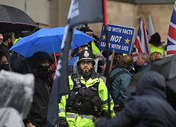 Pictured: Police on duty during the demonstration outside the conference venue.<br /> <br /> protesters demonstrated on the first day of the Conservative Party conference in Manchester.<br /> <br /> © Dave Johnston / EEm