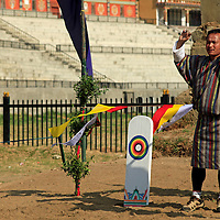 Asia, Bhutan, Thimpu. Archery is the national sport of Bhutan, and here is an archer next to the target.