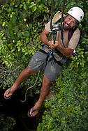 A ecotourism guest catches a lift into the Morite canopy platform.