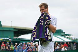 LONDON, ENGLAND - Wednesday, June 29, 2016: Tomas Berdych (CZE) using his Wimbledon towel during the Gentlemen's Singles 1st Round match on day three of the Wimbledon Lawn Tennis Championships at the All England Lawn Tennis and Croquet Club. (Pic by Kirsten Holst/Propaganda)