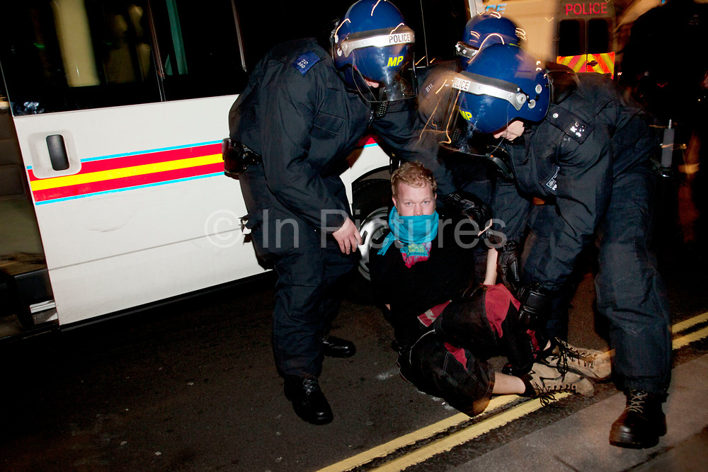 Police arresting a protester as eviction of the Occupy London OLSX camp takes place. The anti-capitalist demonstration that saw protesters camp outside St Paul's Cathedral in London was brought to an end by bailiffs and police. Protesters staging Occupy London were refused permission by the Court of Appeal last week to challenge orders evicting them from the cathedral steps, where they had been living in tents since October 15 last year. The City of London Corporation called on protesters to remove their tents voluntarily, but around 50 or 60 refused to budge. Some protesters created makeshift barriers out of wooden shelving units as police moved in to help bailiffs clear the camp. Police said 20 people had been arrested but the operation was largely peaceful.
