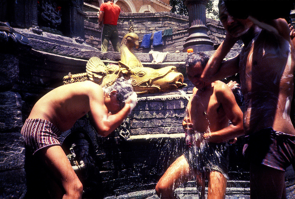Men lather-up and wash in the sunshine at Sundhara, an open-air, public baths in Kathmandu. It's decorated with stone carvings of various gods and a stunning, gilded fount in the shape of a mythological beast, the makara, a sort of crocodile. This fantastic fountain is said to have been built at the order of an aunt of the king in 1832, but the ancient underground aqueduct system serving it and the Kathmandu Valley is far older, its origins dating back, it is thought, to the sixth century A.D.