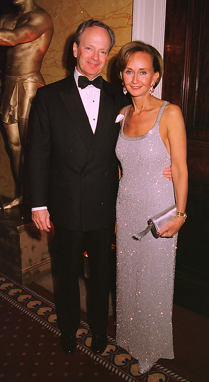 YVONNE, MARCHIONESS OF BRISTOL and her fiancee MR CHARLES NORRIS, at a party in London on 30th January 1999.MNP 26