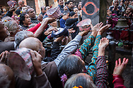 Nepal. Hindu devotees gathered around the Vishnu Temple in Bhaktapur, are ready to recive the blessed water.