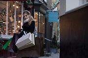 Girl shopping in Mayfair,  London, UK.