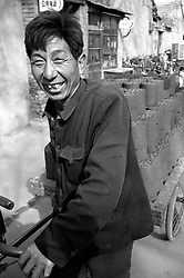 Man delivering coal in a hutong in Beijing
