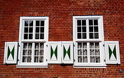 Detail of ornate windows of Dutch style houses in historic Potsdam in Germany