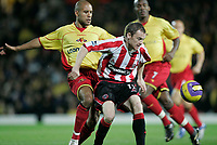Photo: Marc Atkins.<br /> <br /> Watford v Sheffield United. The Barclays Premiership. 28/11/2006. James Chambers of Watford in action with  Alan Quinn of Sheffield Utd.