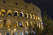 Night view of the Flavian Amphitheater, Colosseum or Coliseum. It is an oval amphitheater in the center of the city of Rome. It is the largest amphitheater ever built. One of the 7 Wonders of the World.