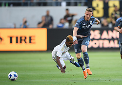 May 13, 2018 - Los Angeles, CA, U.S. - LOS ANGELES, CA - MAY 13: New York City midfielder Alexander Ring (8) collides with Los Angeles FC forward Latif Blessing (7) during the game between New York City FC and the Los Angeles FC on May 13, 2018, at Banc of California Stadium in Los Angeles, CA. (Photo by David Dennis/Icon Sportswire) (Credit Image: © David Dennis/Icon SMI via ZUMA Press)