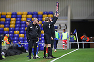 AFC Wimbledon manager Mark Robinson about to make a sub during the EFL Sky Bet League 1 match between AFC Wimbledon and Gillingham at Plough Lane, London, United Kingdom on 23 February 2021.