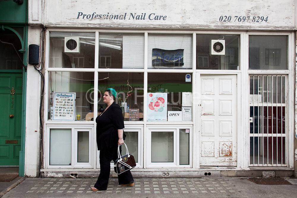 Mother Louise Irwin-Ryan outside a nail clinic in her neighbourhood of Barnsbury, near to Kings Cross, North London. Louise is on various benefits to help support her family income, and housing, although recent government changes to benefits may affect her family drastically, possibly meaning they may have to move out of London. Louise Ryan was born on the Wirral peninsula in 1970.  She moved to London with her family in 1980.  Having lived in both Manchester and Ireland, she now lives permanently in North London with her husband and two children. Through the years Louise has battled to recover from a serious motorcycle accident in 1992 and has recently been diagnosed with Bipolar Affective Disorder. (Photo by Mike Kemp/For The Washington Post)
