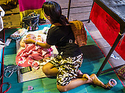 08 DECEMBER 2016 - BANGKOK, THAILAND: A cast member feeds her baby before a Chinese opera (also called ngiew in Thailand) performance at Pek Leng Keng Shrine in the Khlong Toei neighborhood of Bangkok. Public performances of music and celebration were banned during the first 30 days of the mourning period for Bhumibol Adulyadej, the Late King of Thailand. Now, nearly two months after the revered monarch's death, Bangkok street life is returning to normal and Chinese temples and shrines are once again scheduling operas.      PHOTO BY JACK KURTZ