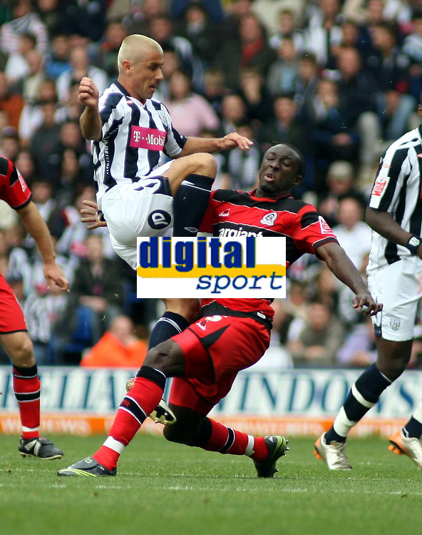 Photo: Mark Stephenson.<br /> West Bromwich Albion v Queens Park Rangers. Coca Cola Championship. 30/09/2007.West Brom's Kevin Phillips goes in hard
