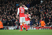 Arsenal midfielder Alex Oxlade-Chamberlain (15) hugging Arsenal attacker Theo Walcott (14) after scoring 1-0 during the Champions League round of 16, game 2 match between Arsenal and Bayern Munich at the Emirates Stadium, London, England on 7 March 2017. Photo by Matthew Redman.