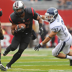 Oct 6, 2012: Rutgers Scarlet Knights defensive back Wayne Warren (27) returns an interception for a touchdown during second half NCAA college football action between the Rutgers Scarlet Knights and UConn Huskies at High Point Solutions Stadium in Piscataway, N.J.