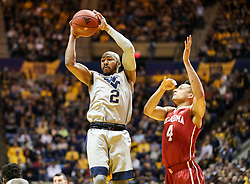Jan 6, 2018; Morgantown, WV, USA; West Virginia Mountaineers guard Jevon Carter (2) jumps for a rebound during the first half against the Oklahoma Sooners at WVU Coliseum. Mandatory Credit: Ben Queen-USA TODAY Sports