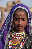 """Portrait of a gypsy girl belonging to a group of nomads who provide entertainment (song and dance) during the Pushkar Camel fair. Pushkar, India<br /> Available as Fine Art Print in the following sizes:<br /> 08""""x12""""US$   100.00<br /> 10""""x15""""US$ 150.00<br /> 12""""x18""""US$ 200.00<br /> 16""""x24""""US$ 300.00<br /> 20""""x30""""US$ 500.00"""
