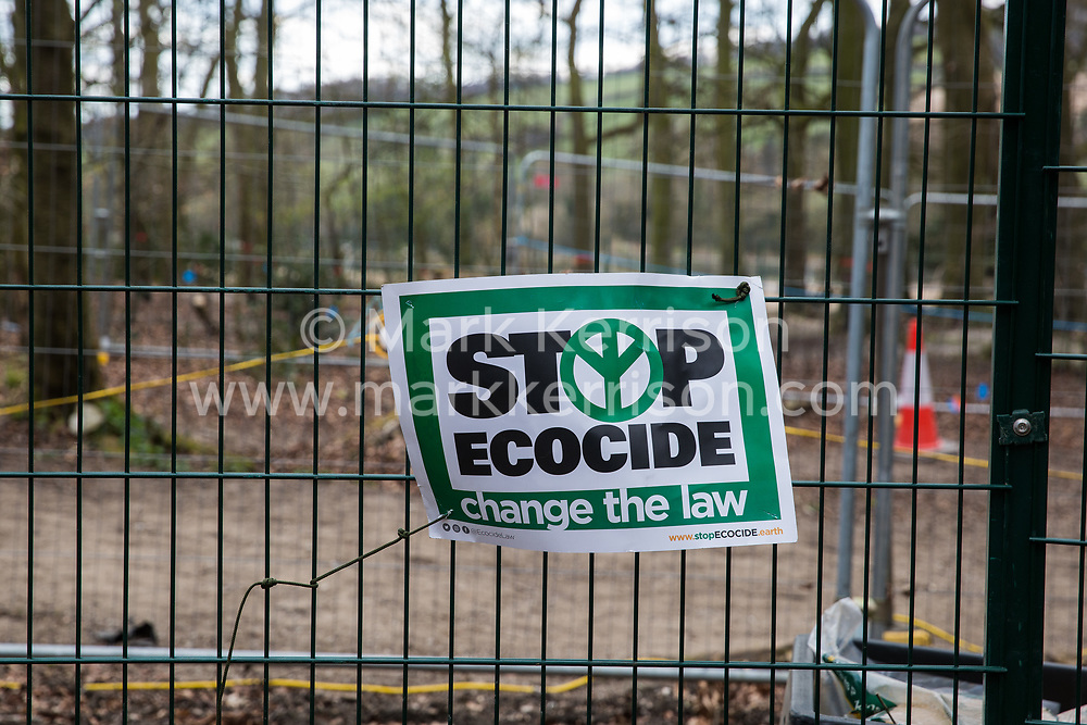Wendover, UK. 9th April, 2021. A sign reading 'Stop Ecocide: change the law' is pictured in Jones Hill Wood, ancient woodland said to have inspired Roald Dahl, during tree felling operations for the HS2 high-speed rail link. Tree felling work began this week, in spite of the presence of resting places and/or breeding sites for pipistrelle, barbastelle, noctule, brown long-eared and natterer's bats, following the issuing of a bat licence to HS2's contractors by Natural England on 30th March.