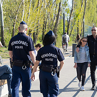 Police officers patrol the bank of river Danube to send people home as public parks are ordered to be closed off from visiting for Easter weekend because of the COVID19 corona virus pandemic in Budapest, Hungary on April 10, 2020. ATTILA VOLGYI