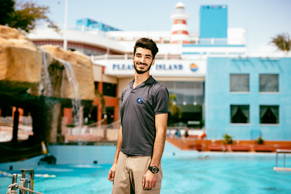 Ahmad Alfuqaha, 21, a Jordanian employee from Aqaba, poses for a portrait at Club Hotel Eilat, a suites hotel in Eilat, southern Israel, on March 15, 2018.