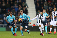 Jay Fulton of Swansea city breaks away from Matt Phillips of West Bromwich Albion.  Premier league match, West Bromwich Albion v Swansea city at the Hawthorns stadium in West Bromwich, Midlands on Wednesday 14th December 2016. pic by Andrew Orchard, Andrew Orchard sports photography.