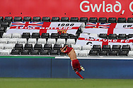 Richarlison of Watford celebrates and takes his shirt off after he scores his teams 2nd goal. Premier league match, Swansea city v Watford at the Liberty Stadium in Swansea, South Wales on Saturday 23rd September 2017.<br /> pic by  Andrew Orchard, Andrew Orchard sports photography.