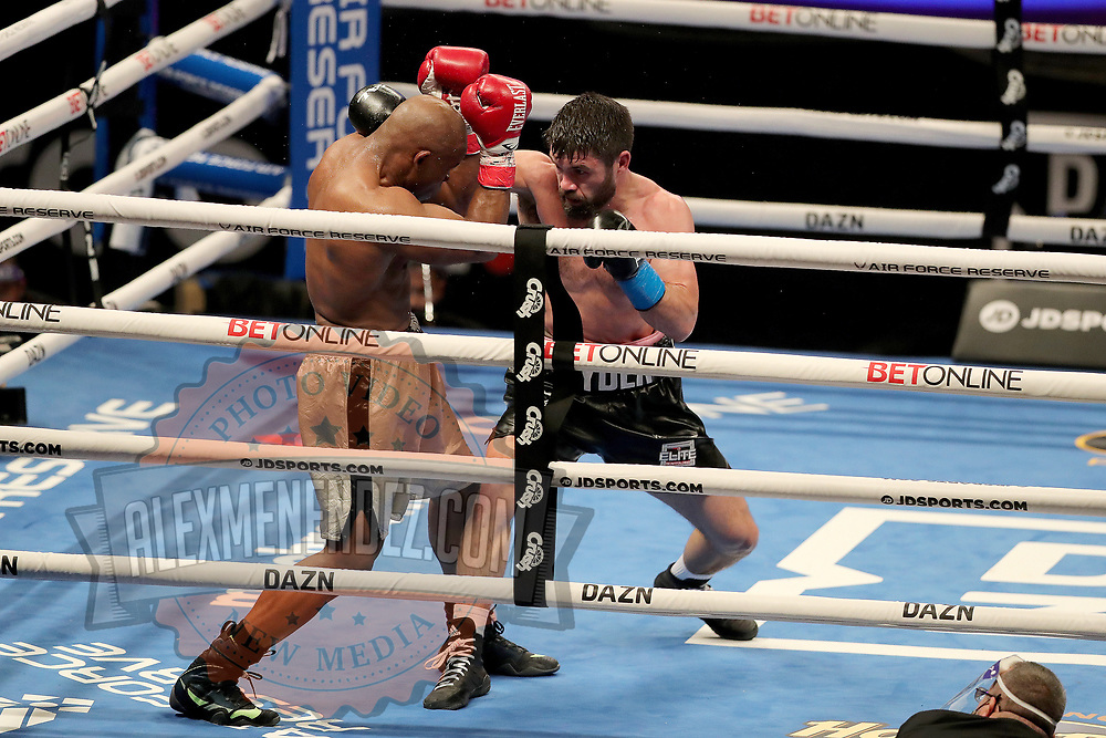 John Ryder punches Michael Guy during the undercard bout of the Gennady Golovkin versus Kamil Szeremeta world title fight at the Seminole Hard Rock Hotel and Casino in Hollywood, Florida USA on 18, Dec 2020. Photo: Alex Menendez