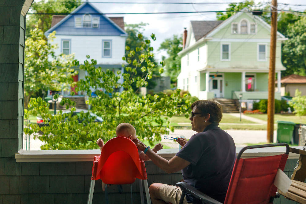 Baltimore, Maryland - August 10, 2016: Oliver & Grammy blowing bubbles on the front porch.<br /> <br /> CREDIT: Matt Roth