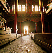 Silouhette of a monk in the doorway of a monastery, Ladakh, India.
