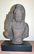 Standing Deity, possibly Shiva 600-700 Chalukya period.  Basalt, South-west India.  The Deccan formed at times a cultural bridge between the arts of the north and the south.  Its medieval rock-cut temples of Ajanta and Ellora are among the most famous in India.