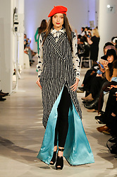 © Licensed to London News Pictures. 19/02/2017. London, UK.  A model presents a look by Syomir Izwa Gupta (Malaysia) on the final day of the UK's first London Modest Fashion Week taking place this weekend at the Saatchi Gallery.  The two day event sees 40 brands from across the world come together to showcase their collections for Muslim and other religious women. Photo credit : Stephen Chung/LNP