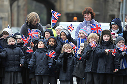 © under license to London News Pictures. 08/12/2010. School Children wave on the soldiers. 12 Logistic Support Regiment The Royal Logistic Corp (12 LSR), based in Abingdon, Oxon and Gutersloh, Germany, march through the centre of Abingdon after being awarded with their Afghanistan Campaign Medals. Members of the public and the soildiers families turned out in the cold weather to cheer the men and women on. Photo credit should read: Stephen Simpson/LNP