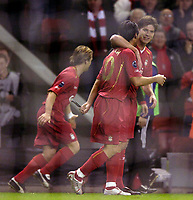 Photo: Jed Wee.<br />Liverpool v Anderlecht. UEFA Champions League.<br />01/11/2005.<br /><br />Liverpool's Xabi Alonso (R) celebrates with goalscorer Luis Garcia.