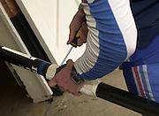 Henley. England, GB Rowing crews training on Henley Reach.<br /> Photo Peter Spurrier.<br /> 11/03/2004 - British International Rowing - Training<br /> Oar adjustment.   [Mandatory Credit. Peter SPURRIER/Intersport Images]