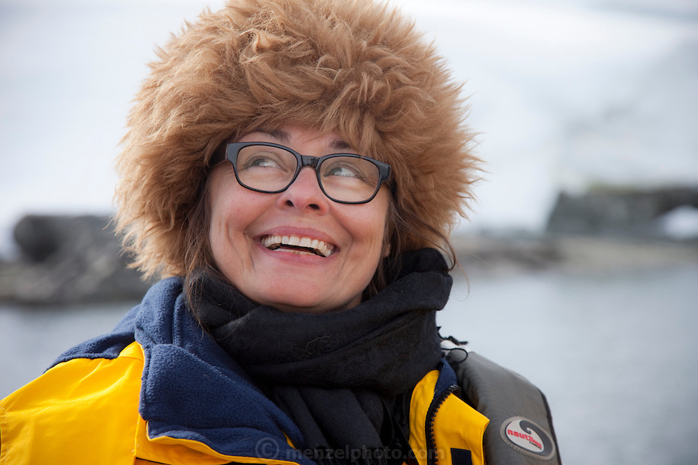 Faith D'Aluisio on a zodiac ride, watching humpback whales with David as driver in Wilhelmina Bay, Antarctic Peninsula. MODEL RELEASED.