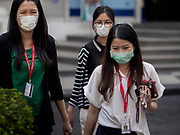 "14 JANUARY 2019 - BANGKOK, THAILAND:       Women wearing breathing filters on the street in Bangkok. Bangkok has been blanketed by heavily polluted air for almost a week. Monday morning, the AQI (Air Quality Index) for Bangkok  was 182, worse than New Delhi, Jakarta, or Beijing. The Saphan Kwai neighborhood of Bangkok recorded an AQI of 370 and the Lat Yao neighborhood recorded an AQI of 403. An AQI above 50 is considered unsafe. Public health officials have warned people to avoid ""unnecessary"" outdoor activities and wear breathing masks to filter out the dust.   PHOTO BY JACK KURTZ"