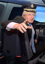 Boris Johnson Opening of The Emirates Aviation Experience.<br /> London Mayor Boris Johnson during the official opening of The Emirates Aviation Experience. The mayor and Emirates president Tim Clark will also hold a Q&A at the attraction, which includes a full-size replica nose-cone of a double-decker A380 complete with flight-deck as well as an A380 flight simulator. <br /> Greenwich Peninsula Terminal, London, United Kingdom Friday, 5th July 2013 Picture by Andrew Parsons / i-Images<br /> <br /> File Photo - New runways at Heathrow and Gatwick are among the options that have been short-listed by the Airports Commission for expanding UK airport capacity.<br /> Date filed Tuesday 17th December 2013. Photo By Andrew Parsons/ i-Images.