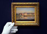 © Licensed to London News Pictures. 17/05/2013. London, UK JOHAN CHRISTIAN DAHL. NORWEGIAN. 1788-1857. VIEW OVER THE ELBE AND THE BARRACKS. Estimate:   15,000 - 20,000 GBP. A photo call for a preview of 19th Century European Paintings held at Sotheby's London today 17th May 2013. The paintings will be offered to auction on 23 May 2013. Photo credit : Stephen Simpson/LNP