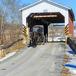 An Amish buggy at the Weaver's Mill Covered Bridge in Lancaster County, Pennsylvania.