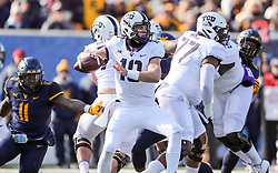 Nov 10, 2018; Morgantown, WV, USA; TCU Horned Frogs quarterback Michael Collins (10) throws a pass during the first quarter against the West Virginia Mountaineers at Mountaineer Field at Milan Puskar Stadium. Mandatory Credit: Ben Queen-USA TODAY Sports